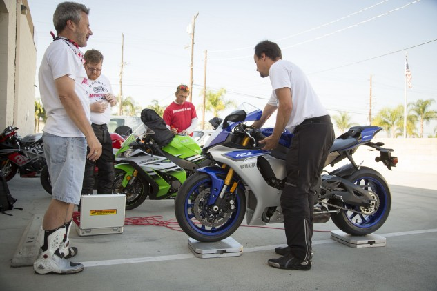 While Evans, Sean and Kevin weigh each bike, Burns is busy staring at something shiny off in the distance.