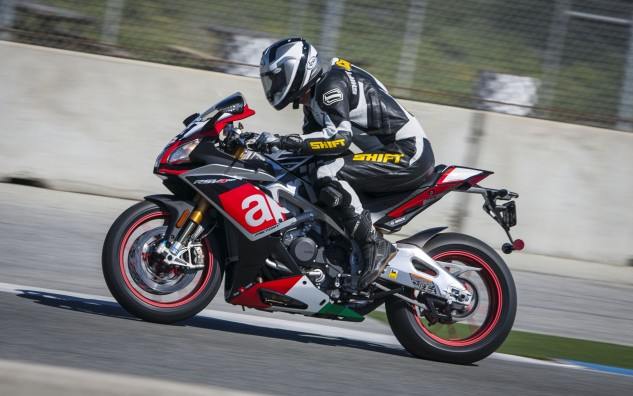 Taller riders might feel a little squished on the Aprilia, as here 5-foot, 11-inch Doug Chandler has his elbows above his knees despite being all the way back on the seat.