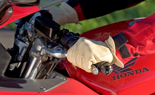 Gloved Hand on Clutch Lever