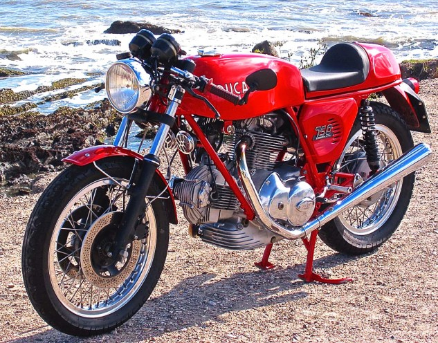 Some motorcycles, like the '74 Ducati 750 Sport, dominate any background with their classic form. The author has let two of these get away over the years. Two. The shame. So this photo remains on the wall to remind him of his errant ways.