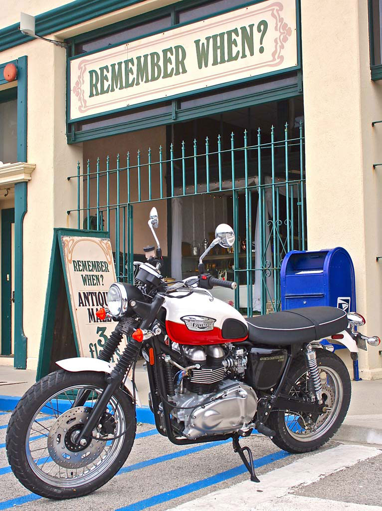 Now and again the motorcycle and backdrop are a thematic match. The retro Triumph Scrambler fits nicely in front of the antique shop, with a finishing vintage touch from the blue mailbox.