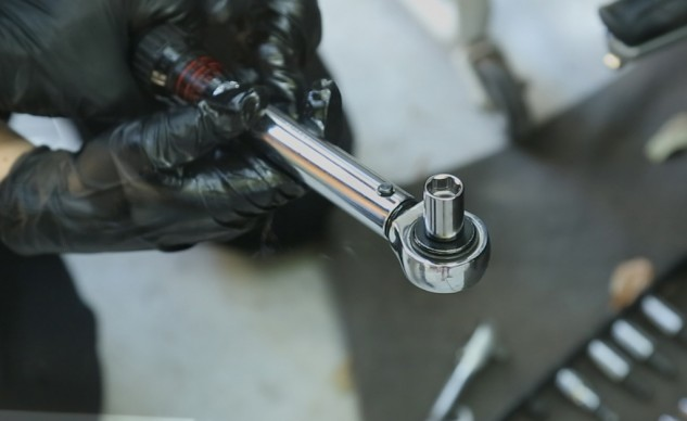 A torque wrench is a good investment that helps prevent you from stripping delicate threads.