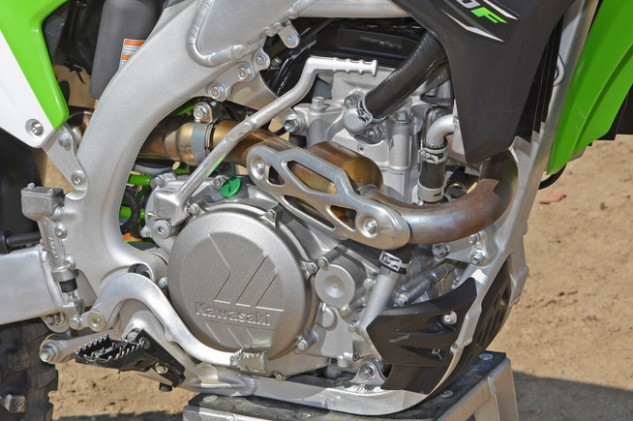The KX450F's 449cc DOHC, four-stroke Single boasts new engine cases that are thinner yet lighter than the previous cases. Its cylinder has been moved forward 8.5mm, its intake ports have been revised, its crankshaft has been lightened, its piston is all-new, and it boasts a more compact 43mm Keihin throttle body among other revisions.