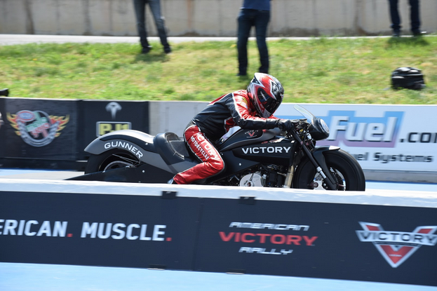 Victory's American muscle theme on display at the American Victory Rally held earlier this summer in Colorado. NHRA Pro Stock racer Matt Smith launches his dragbike a low-7-second pass down Bandimere Speedway's quarter-mile strip. Photo by Barry Hathaway.