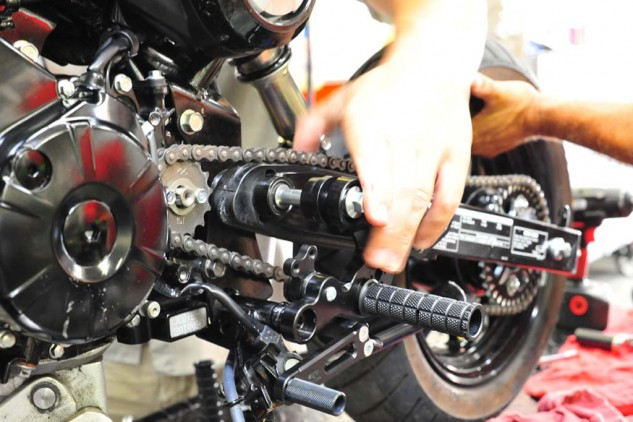 Installation of the rearsets is relatively simple; thread the long bolt through the shift side, then the swingarm, then the rear brake side. Then tighten top and bottom bolts to factory specs.