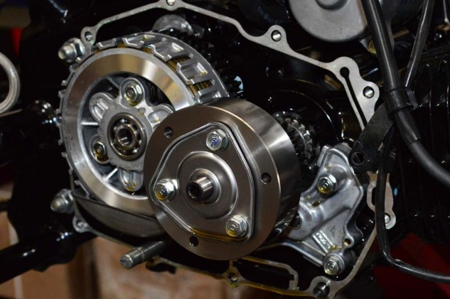 With the cover removed we see the clutch basket on the left and the stock oil pump on the bottom right.
