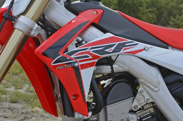 If there's one thing we can't stand about the CRF2540R (and CRF450R), it is that their radiator shrouds (and especially those black louvers that protrude just below them) snag boots and kneeguards with reckless abandon during cornering. The situation spoils an otherwise comfortable ergonomic layout.