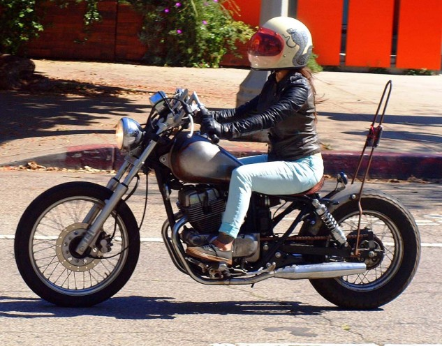 Paul's Pick Best Lady Rider on Honda Rebel Chopper with Sissybar and Bubble Snake Graphic Helmet.
