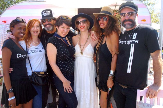 Dressing for Vintage Success. (left to right) Bihou, Jenna, Christopher, Ginger, Kallah Maguire, Kim and Russ gather in front of Kallah's 1964 Jet trailer that serves as her mobile vintage fashion boutique. Russ, far right, an IT guy by profession, races vintage bikes including the Isle of Man TT event.