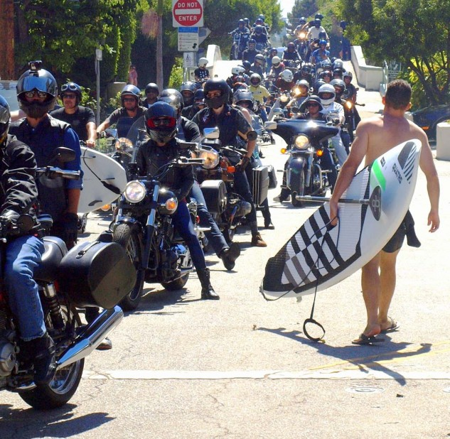 The morning ride drew hundreds as paddle boarders and surfers step into a tsunami of bikers.
