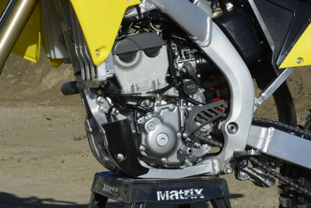 Suzuki engineers labored to give the RM-Z250's liquid-cooled, fuel-injected DOHC engine a little more pep for 2016. It shares the same bore and stroke as the previous version, but a new piston, crank, intake valves and cams are among the host of updates it has received.