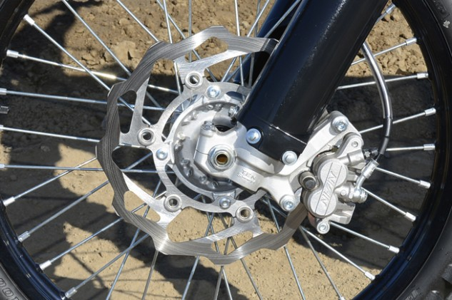 Kawasaki designed its massive 270mm front wave rotor with Braking. The two-piston caliper is a Nissin. The KX delivers excellent stopping power and a linear braking feel.