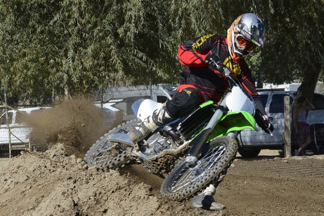 The tradeoff for the KX's high-speed stability is a machine that must be coaxed to hold a tight line in flat or rutted corners. The KX's front-end delivers a vague feel unless you steer it with the throttle.