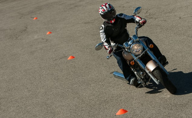 The Hyosung's steering characteristics are more neutral compared to the Star, and the wider bars give the rider leverage. However, the grabby clutch poses its own set of challenges when navigating slowly, say, through a cone course.
