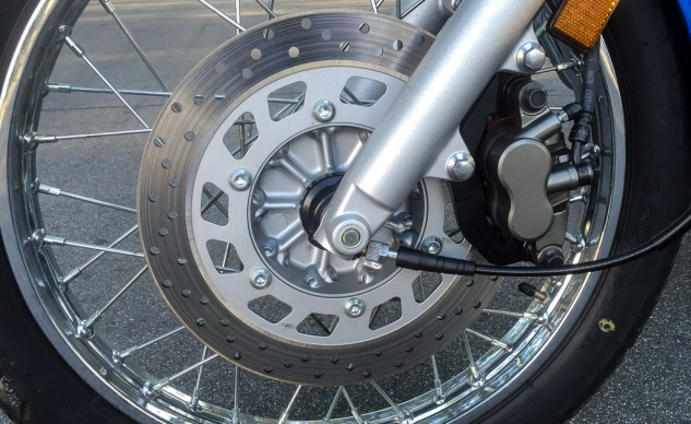 Both the Hyosung and Star utilize single discs in the front, both with two-piston calipers. Drum brakes slow the rear wheel. The Star's disc (seen here) is 282mm compared to the 275mm disc on the Hyosung. Neither system is particularly noteworthy, but adequate for the job. That black cable is one end of the mechanical speedometer. Low tech at its finest.