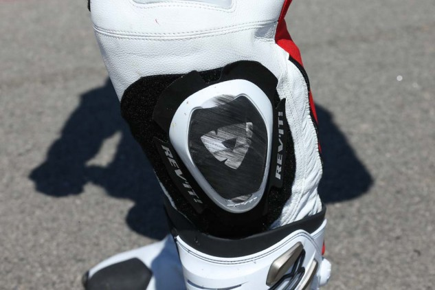 Rev'It knee sliders are of the TPU dual-compound type A variety. Knees are protected by a pre-shaped honeycomb structure of TPU material and a high-impact aluminum shield (out of frame). The inside of the knee also features a removable rubber insert for increased grip when hanging off the bike.