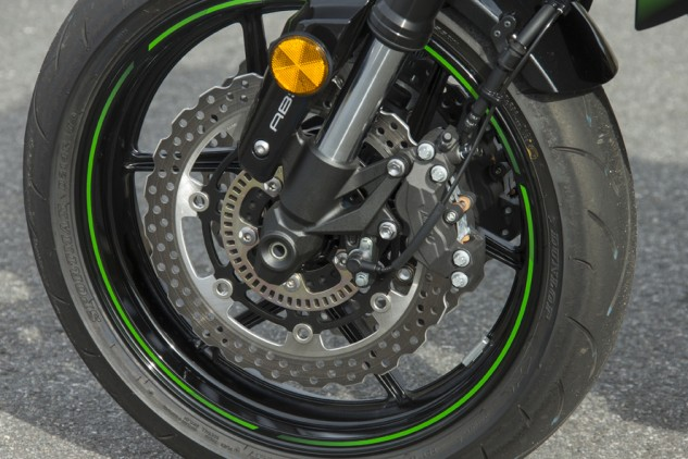 Petal-type discs are on the smaller side at 277mm, but despite the non-radial caliper arrangement there are no big complaints in the Z800's braking. Note also the ABS ring – the only sign of 21st century tech on this bike. Dunlop Sportmax D214 tires sit front and rear in 120/70-17 and 180/55-17 sizes.