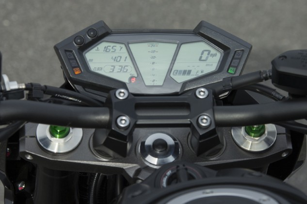 The LCD instrument cluster features a vertical bar graph tachometer in the center with speed displayed in numerals to the right. Other displays include odometer, two tripmeters, average mpg, instant mpg, clock, engine temp and fuel gauge. Unfortunately, there isn't a gear-position indicator. With some pushes of the two buttons on the top left, the screen can switch colors and show a black background with white lettering instead of the standard black letters on a white background seen here.