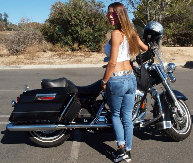 Best Expletive Not-Deleted: As a teenager Colleen Duffner rode a 1977 Harley XLCR café racer to high school and bought her black '04 Road King new. Belt is not H-D accessory.