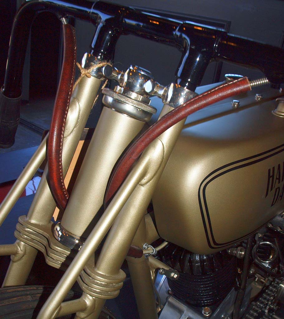 "The bronze Harley is called ""The Chicago Racer"" and hails from 1923. Incredible detailing includes correct leather wrapping of cables."