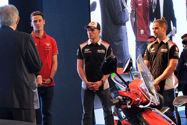 Colaninno speaks to Aprilia's roadracers, Lorenzo Savadori (Superstock 1000 world champ) and MotoGP riders Stefan Bradl and Alvaro Bautista. Bautista was showing off his man-bun, which is a hairstyle uncomfortably gaining in fashion, according to what I saw in Milan.
