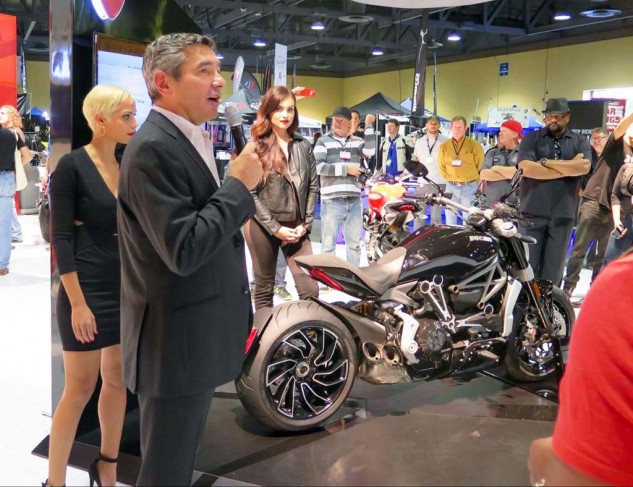 Ducati was the only big manufacturer to bring fashion models, beer and snacks, and are reporting sales through the roof. Coincidence? North American CEO Dominique Cheraki reveals the new XDiavel and its new variable-valve timing engine (my personal hit of the show).