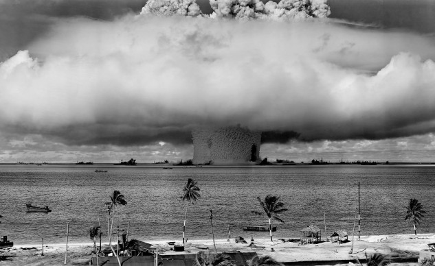 Since I don't want to post horrible photos of human bodies mangled and disfigured, I've posted this photo of the Bikini Atoll atomic bomb tests, because it's a really cool photo. No people were harmed, but there were goats and pigs on the ships.