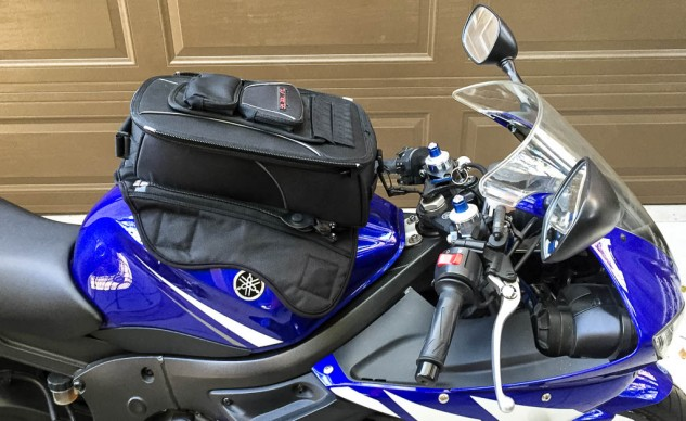 The bottom section can be used as a lower-profile tank bag, though it is a little less stylish than the main section.
