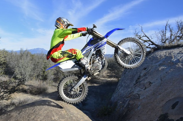 "Steeper first, second and third gear ratios and off-road-specific ECU conspire to turn the YZ450FX into a mountain goat on steroids. Its low-end tractability and smooth yet brawny power output can make short work of technical obstacles like this rock. Test rider Nic Garvin goes for the proverbial ""leap in a single bound."""