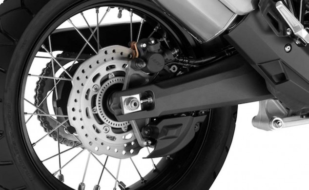 The parking brake (beneath the swingarm) on DCT models is separate from the rear brake (top of swingarm) used when riding.