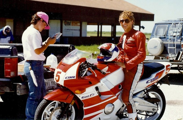 Me and the CBR600F2 I bought new in 1991 based on the glowing reviews I read in every print magazine. The money I saved racing on the stock Michelins went to my head: a Jimmy Adamo Arai and a perm! Note the pre-knee-puck Dainese leathers.