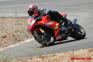 The Aprilia RS125 is considerably larger and heavier than the Moriwaki, but it still comports itself well on a racetrack.