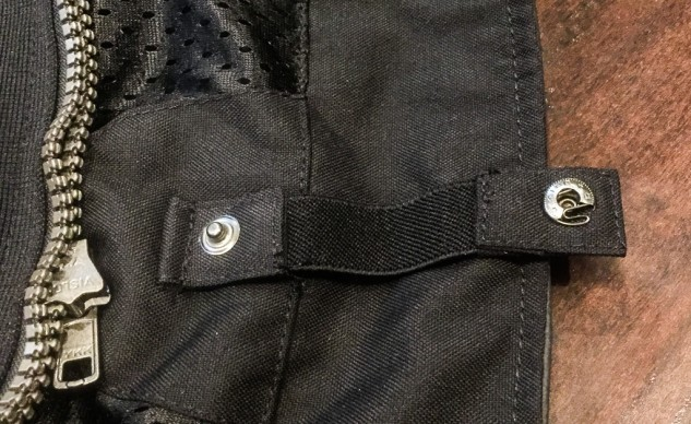 Oops! At least this snap is an easy fix. I still don't understand why more motorcycle jackets don't have these belt loops.