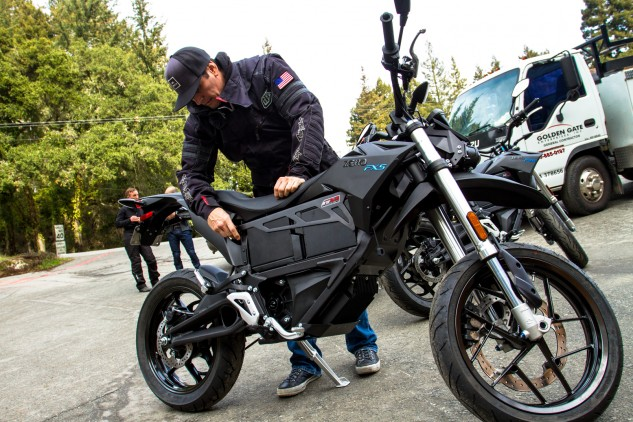 Zero's TJ Aguirre in the process of removing the retaining bar for the swappable batteries. The premise for the removable batteries was inspired by Zero's military contracts, which stipulated that the motorcycle had to be able to go from zero to full charge in 60 seconds or less. There was no way Zero's existing batteries and charging systems could achieve this, so the solution was to simply make the batteries removable and replaceable.