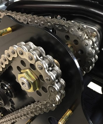 This jackshaft arrangement is what connects the power transmitted through the engine's countershaft sprocket to the track.