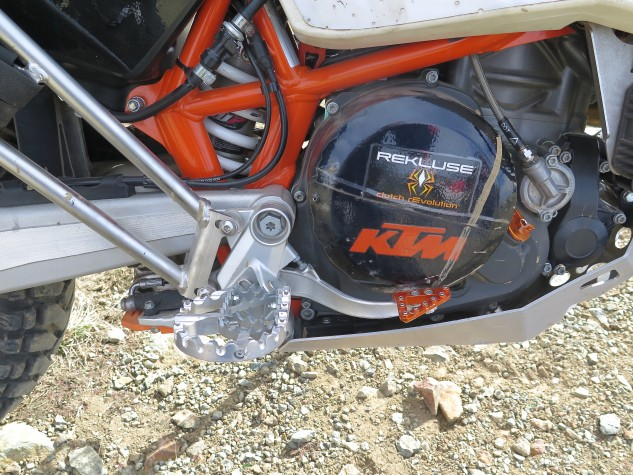 A Rekluse automatic clutch makes riding easier with fewer limbs; wide footpegs are from ZipTy. Touratech racks can mount big panniers or soft luggage.