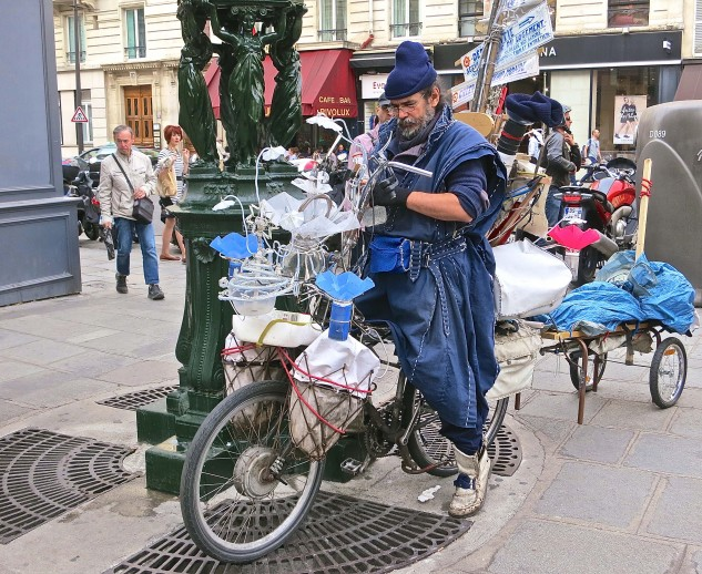 On the sidewalks of Paris, one sees all manner of conveyances, characters and costumes. Some of which do defy description.