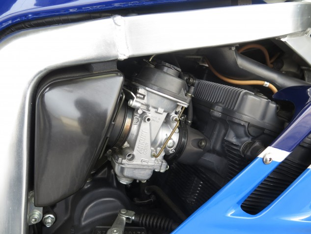 """Mikuni BST40 """"open air"""" carburetors are supposed to facilitate quick jetting changes; the cam cover is magnesium."""