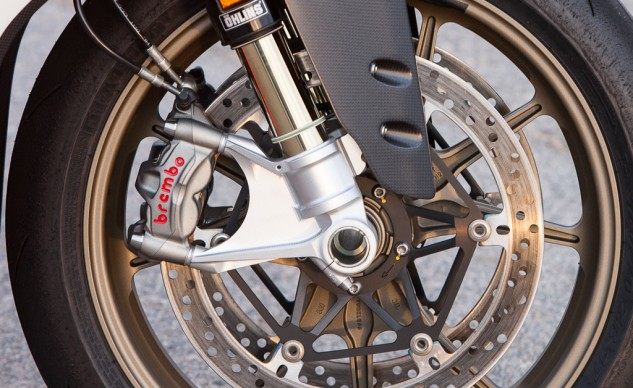 Plenty of lightweight moto jewelry abounds. Öhlins suspension is de rigueur on high-end Ducatis, but the Superleggera's is super special. The fully adjustable FL916 fork with billet-aluminum bottoms and anti-stiction titanium-nitride coating is said to be 3 lbs(!) lighter than the R's. Out back, the Öhlins TTX36 shock is fitted with a titanium spring to further shave weight. Wheels are forged from ultra-light magnesium. Brembo M50 calipers offer unrivaled strength and feedback.