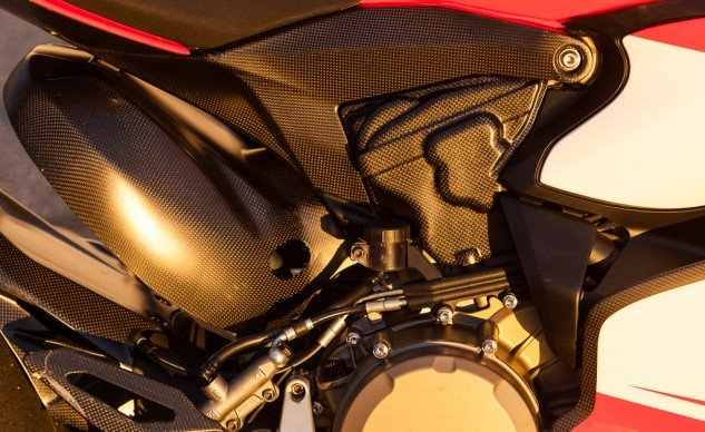Carbon fiber is prominently featured on the Superleggera, seen here in heat shielding for the rear cylinder and its header, footrest heelguard and fairing panels. The carbon rear subframe supports the seat and tail structure while weighing just 2 lbs.