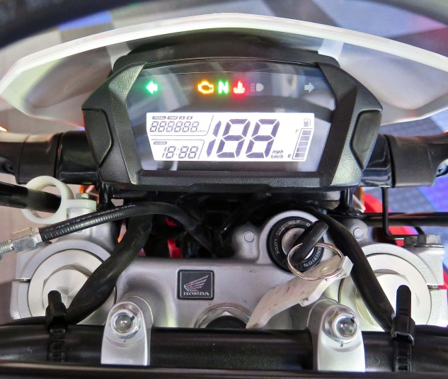 Everything you need to know is right there. No, there's neither ride modes nor ABS. The fuel gauge isn't too accurate, but the tripmeter will go a bit more than 120 miles on each 2.0-gallon tank.