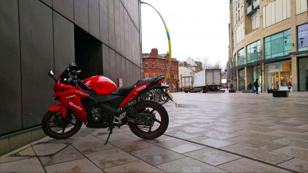 "If British motorcyclists can't find any nearby free parking they will simply park on the sidewalk (a.k.a. ""pavement""). A quirk of British law classifies motorcycles as bicycles for tax purposes, so savvy riders park near bicycle racks."