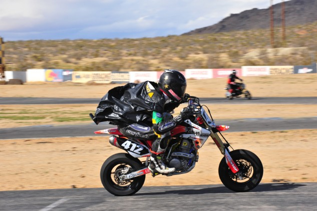 Former AMA National Supersport champion and current Alpinestars graphic designer, Austin DeHaven, showing off the trash bag rain suit. Don't expect it to appear in the Alpinestars catalog any time soon.