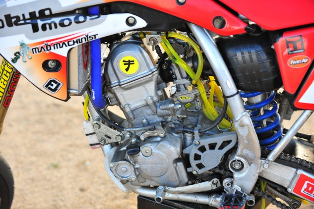 Vollmer seems to have perfected the art of CRF150R engine tuning. According to King, stock versions are notorious for hesitation from the carb on initial throttle. No such thing here. Just crisp acceleration.