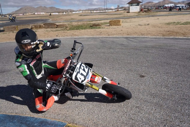 Rafael DiSilva getting a knee down with ease on the Mad Labs CRF150R and waving to the camera, too.