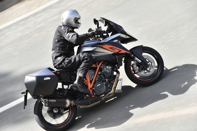Unsurprisingly, the GT proves to be easy to ride quickly with the same neutral handling enjoyed from the SDR. The bike feels nicely narrow between knees despite the larger volume of the fuel tank. It scales in fully fueled (about 37 lbs of gas) at 503 lbs.