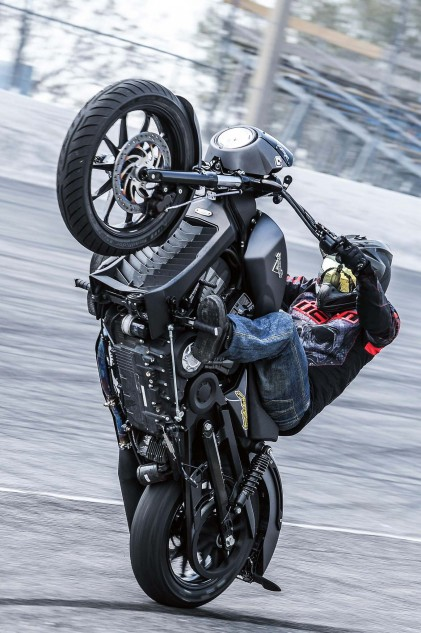 Victory stunt rider, Tony Carbajal, demonstrates how easy it is to access the Octane's oil filter.