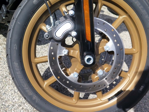 The latest in 300mm floating discs mounted directly to the 19-inch wheel meets the latest Michelin bias-ply rubber – the company that invented motorcycle radials in 1984. It all works. ABS is standard with the ABS sensor cleverly hidden in the wheel bearing.
