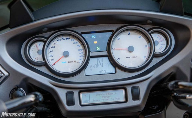The stereo's information screen is on the bottom. Despite its diminutive size and dated monochrome layout, it effectively delivers all the data the rider needs.