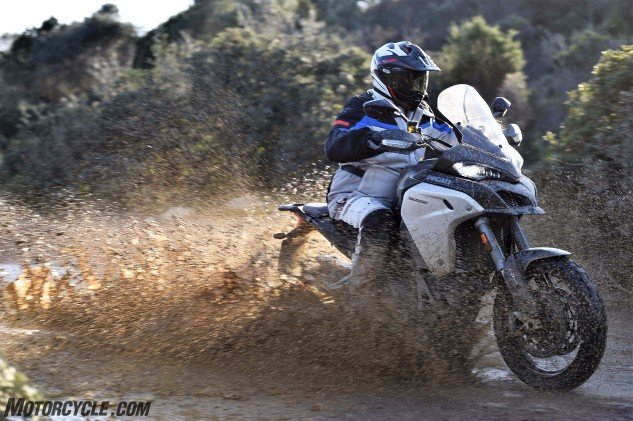 """The big Twin, big rider, big curb weight and optional Pirelli Scorpion """"Rally"""" tires all conspire for an abundance of traction, even in mud… Just don't stop!"""